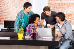 People office diverse mix race group businesspeople laughing. Discussing happy smile laptop computer casual wear royalty free stock image