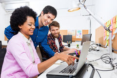 People office diverse mix race group businesspeople working woman point finger laptop Royalty Free Stock Images