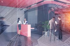 People in office lobby with reception desk royalty free stock photo