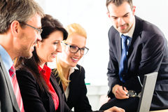 People in office working as team Stock Photos
