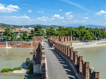 People at old bridge in Verona over Adige river - Castelvecchio Stock Image