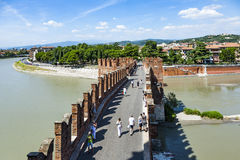 People at old bridge in Verona over Adige river - Castelvecchio Stock Photography