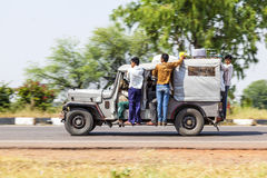 People in an old indian truck driving on a highway Royalty Free Stock Photo