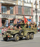 People in the old military truck. Royalty Free Stock Photography