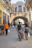 People and old shabby buildings in Havana Royalty Free Stock Image