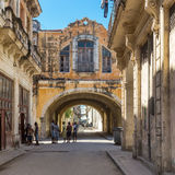 People and old shabby buildings in Havana Royalty Free Stock Photo