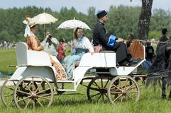 People in old wear ride in the carriage Royalty Free Stock Photo