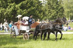 People in old wear ride in the carriage Stock Image
