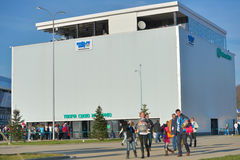 People in the Olympic park during Winter Olympics. Sochi, Russia - February 12, 2014: People near the pavilion of the mobile operator Megafon in the Olympic park Stock Photo