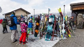 People in the Olympic Village in Sochi, Russia. Sochi - March 29, 2017: Many happy people in colorful colorful winter ski clothing in the Olympic Park March 29 Stock Photo