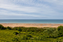People on Omaha Beach Normandy. Royalty Free Stock Images