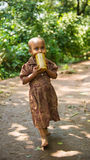 People in OMO, ETHIOPIA. OMO, ETHIOPIA - SEPTEMBER 20, 2011: Unidentified Ethiopian beautiful little girl with a yellow cup of water. People in Ethiopia suffer Royalty Free Stock Photography
