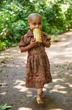 People in OMO, ETHIOPIA. OMO, ETHIOPIA - SEPTEMBER 20, 2011: Unidentified Ethiopian beautiful little girl with a yellow cup of water. People in Ethiopia suffer Stock Photography