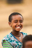 People in OMO, ETHIOPIA. OMO, ETHIOPIA - SEPTEMBER 22, 2011: Unidentified Ethiopian smiling little boy. People in Ethiopia suffer of poverty due to the unstable Royalty Free Stock Image
