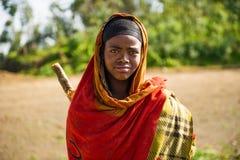 People in OMO, ETHIOPIA. OMO, ETHIOPIA - SEPTEMBER 22, 2011: Unidentified Ethiopian wearing the orange traditional clothes. People in Ethiopia suffer of poverty Royalty Free Stock Photos