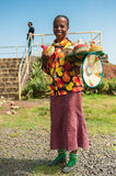 People in OMO, ETHIOPIA. OMO, ETHIOPIA - SEPTEMBER 20, 2011: Unidentified Ethiopian woman sells traditional vases and wears tradtional clothes. People in Royalty Free Stock Image