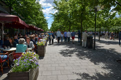 People in one of the most popular parks in Stockholm, Sweden. Restaurants and strolling people in Kungstradgarden, one of the most popular parks in downtown Stock Photo