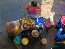 People at an open market in a developing country. People selling and buying food at an open street market in a developing country Stock Photography