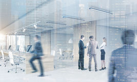 People in open office with meeting room, cityscape Stock Photos