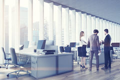 People in an open space office, side, toned Royalty Free Stock Image