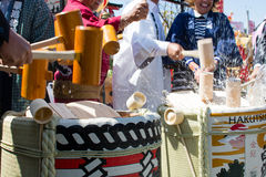 People Opening a Sake Barrel. In celebration of the Cherry Blossom Festival in San Francisco, people used wooden mallets to break open Sake Barrel to share a Royalty Free Stock Image