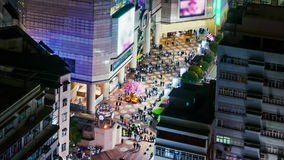 People on the opening space of a shopping mall. Wide Zoom In Shot. Stock Photography