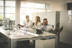 People in operations center  talking on Landline phone. Operator. People in operations center  talking on Landline phone together. Cheerfully Stock Image