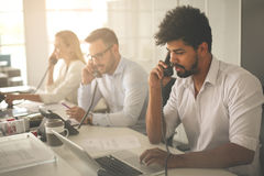 People in operations center talking on Landline phone. Royalty Free Stock Photography