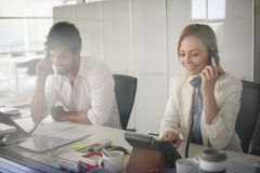 People in operations center  talking on Landline phone. Operators in the office Royalty Free Stock Photo