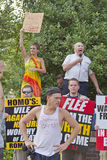 People With Opposing Religious and Gender Beliefs Hold Signs and Stock Image