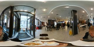 People order fast food in cafe. Moscow, Russia - October 13, 2017: People order fast food in cafe. 360 vr content Royalty Free Stock Images