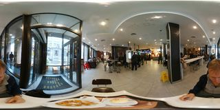 People order fast food in cafe. Moscow, Russia - October 13, 2017: People order fast food in cafe. 360 vr content Stock Photos