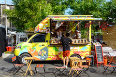 People order meal from food trucks at Food Truck Fair in Bangkok. Royalty Free Stock Image