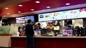People ordering food at mcdonalds check out counter stock video