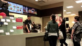 People ordering food at mcdonalds check out counter stock video footage