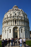 People in and out from Pisa Baptistery in famous Piazza del Duomo  Piazza dei Miracoli . Unesco Wo Royalty Free Stock Images