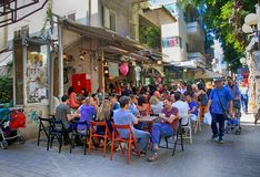 People in outdoor cafe on Dizengoff Street in Tel Aviv, Israel. TEL AVIV, ISRAEL - APRIL 1, 2016: People in outdoor cafe on Dizengoff Street in Tel Aviv, Israel Royalty Free Stock Images