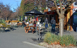 People at outdoor cafe in Hanmer Spings New Zealand. Royalty Free Stock Photos