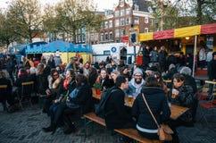 People in outdoor cafe on Nieuwmarkt in Amsterdam, Netherlands. stock image