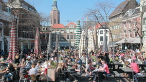 People in outdoor cafetarias in The Hague, Holland stock video