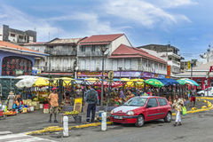 People at the outdoor market in Guadeloupe. POINTE-A-PITRE, GUADELOUPE - MAY 17, 2015: people at the outdoor market in Guadeloupe. The Pointe-a-Pitre Market is Stock Photography