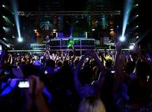 People in outdoor nightclub. Dancing people in outdoor nightclub Royalty Free Stock Image