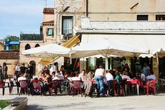 People at an outdoor street restaurant Royalty Free Stock Photo