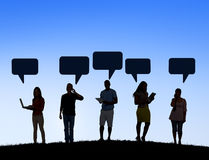 People Outdoors Social Networking and Speech Bubble Stock Images