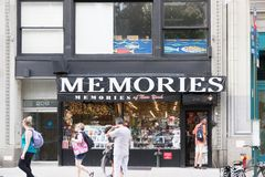 People outisde a gift shop near Times Square in New York City royalty free stock photography