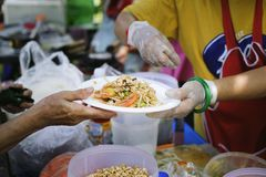 People outreach to donate food from volunteers : Food concept of hope : Free food for poor and homeless people donates food to. Food less people : Social royalty free stock photography
