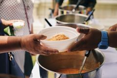 People outreach to donate food from volunteers : Food concept of hope : Free food for poor and homeless people donates food to. Food less people : Social royalty free stock photos