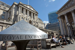 People outside the Bank of England and The Royal Exchange in City of London, UK Royalty Free Stock Images
