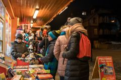People outside bookshop in winter Royalty Free Stock Photo