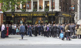 People outside a pub socialising. London, United Kingdom - June 14, 2013: Smart looking people outside a famous pub in London having Friday night drinks. Here Stock Images